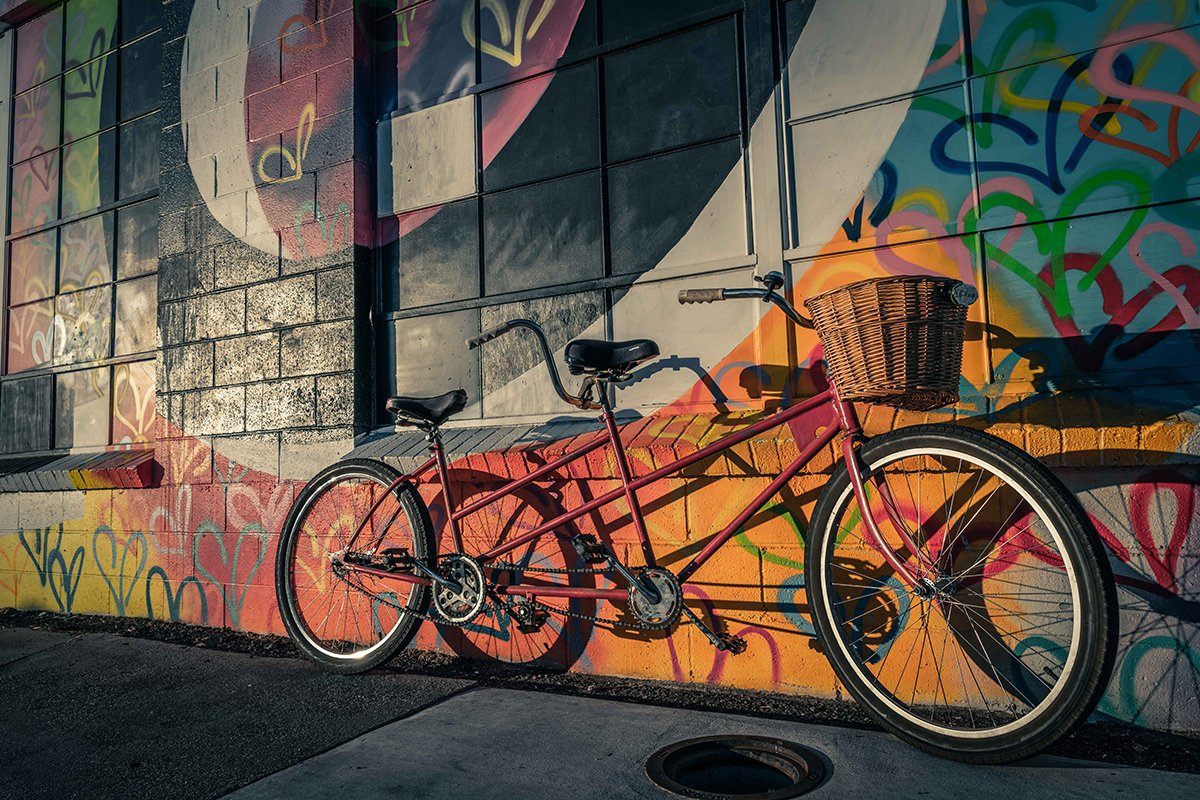 Tandem Bike Leans on a Mural Wall - Website Design & Photography Based in Chico, CA